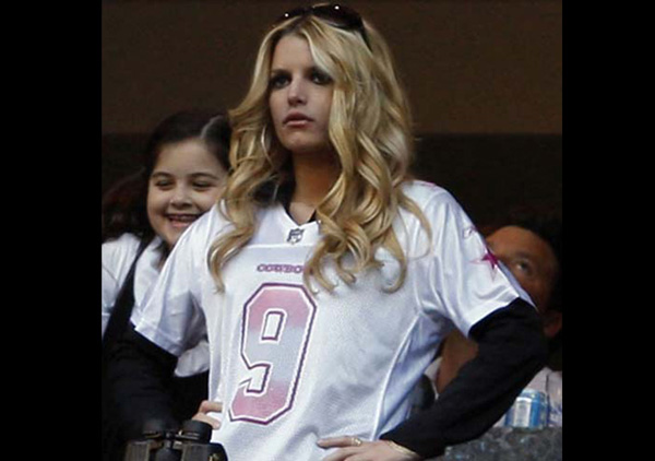 Jessica Simpson in a pink football jersey